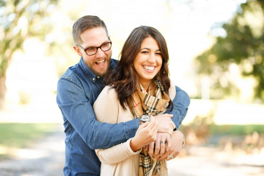 A young couple looking forward to saving money on affordable coverage options